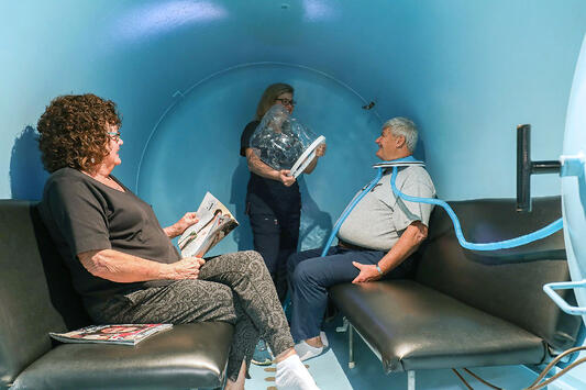 patients getting prepped by nurse in hyperbaric chamber